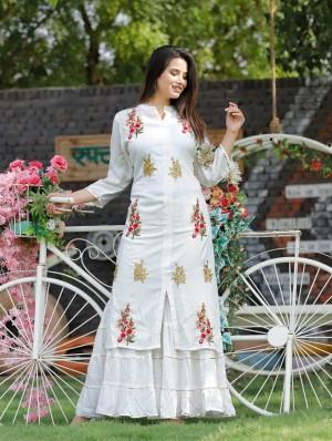 White kurti and sharara with heavy embroidery work